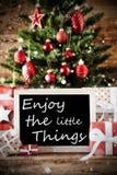 A árvore de Natal com citações aprecia as coisas pequenas Imagem de Stock