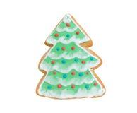 Árvore de Natal da cookie com a neve isolada no branco fotografia de stock