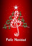 A árvore de Natal feita de notas musicais verdes, barra de chocolate deu forma à clave de sol e ao pentagram com título: NAVIDAD  Fotografia de Stock Royalty Free