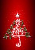 A árvore de Natal feita de notas musicais verdes, barra de chocolate deu forma à clave de sol e ao pentagram no fundo vermelho co Fotos de Stock