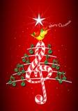 A árvore de Natal feita de notas musicais verdes, barra de chocolate deu forma à clave de sol e o canto e o título amarelos do pá Fotografia de Stock