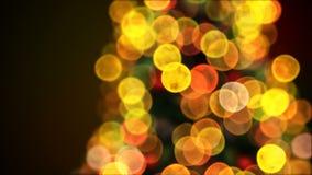 A árvore de Natal de gerencio ilumina o close-up de cintilação no borrão Bokeh Animação 3D dada laços Cartão animado alegre filme