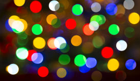 A árvore de Natal ilumina o fundo de Bokeh imagens de stock