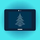 Árvore de Natal na tela da tabuleta Fotografia de Stock Royalty Free