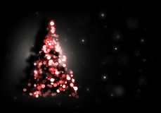 Árvore de Natal que brilha no preto Fotos de Stock