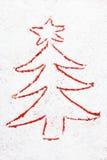 Árvore de Natal vermelha tirada na neve Imagens de Stock Royalty Free