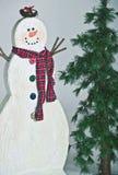 Árvore do boneco de neve e de pinho imagem de stock