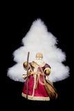 Árvore do White Christmas da estatueta de Santa Claus no fundo preto Foto de Stock Royalty Free