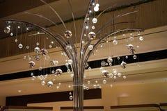 Árvore iluminada de brilho para a véspera de Ano Novo Imagens de Stock