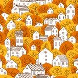 Árvores e cores sem emenda do amarelo alaranjado do outono do teste padrão das casas Fotos de Stock Royalty Free