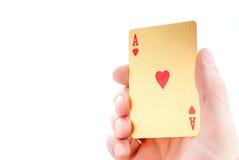 Ás dourado em uma mão Imagens de Stock Royalty Free