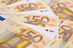 Ás entre euro- contas Fotos de Stock Royalty Free