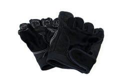 Áspero negro de cuero de los guantes usado en blanco aisló el fondo Fotografía de archivo