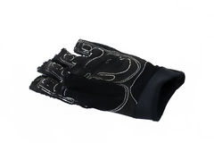 Áspero negro de cuero de los guantes usado en blanco aisló el fondo usado para la aptitud, levantamiento de pesas Imagen de archivo libre de regalías