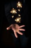 Átomos de flutuação da mão Fotos de Stock