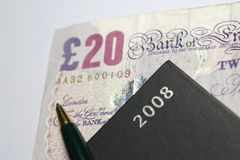 £20 Note With Diary and Pen Royalty Free Stock Photography