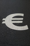 € sign on asphalt Stock Photo