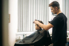 Little Boy Getting Haircut By Barber While Sitting In Chair At Barbershop. Stock Images