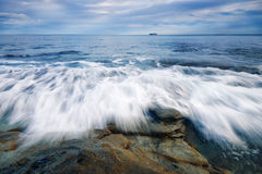 �Rocks and waves at Kings Beach, QLD. Royalty Free Stock Image