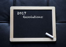 '2017 resolutions' written on black board. The words '2017 resolutions' written on black board Stock Photos