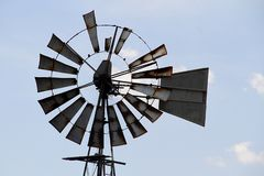 Windmill in the middle of a wheat-land and blue sky, white clouds.. 'The Swartland is the bread basket of the Cape' is very true, however, there is stock photos