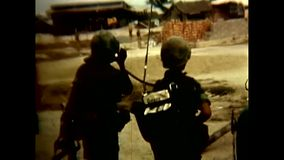 1968 – U S  Soldiers Carrying An Injurned Soldier Stock Footage
