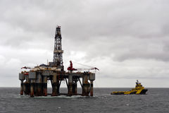 16.06.2014 –Rigmove of Ocean Princess. Rig move of the Semi-Submersible rig Ocean Princess in North Sea. In the photo is also the AHTS Odin Viking, retrieving Royalty Free Stock Photos