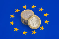 ��Euro coins on the EU flag Stock Image