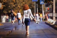 girl walks at street Stock Image