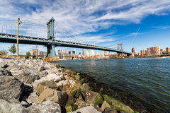 NEW YORK - AUGUST 22. Views of the Manhattan Bridge on a summer day on August 22, 2015. Its a famous and iconic bridge in New York, which passes the Stock Images