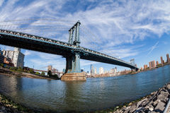 NEW YORK - AUGUST 22: Views of the Manhattan Bridge on. A summer day on August 22, 2015. Its a famous and iconic bridge in New York, which passes the Royalty Free Stock Image