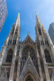 ​MANHATTAN, NEW YORK. ​NEW YORK - SEPTEMBER 19: View to the St. Patricks Cathedral in Midtown Manhattan with the famous 5th Avenue on SEPTEMBER 19, 2015. Its Stock Photos