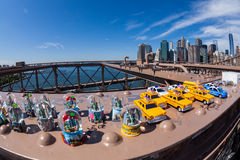 NEW YORK - AUGUST 22. Toys on the Brooklyn Bridge with view to Downtown skyline of New York on August 22, 2015. Its a famous and iconic bridge in New Royalty Free Stock Photography