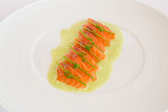 ​raw salmon. Thinly sliced ​​raw salmon with herbs Royalty Free Stock Image