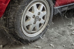 80�s tire among cobwebs Stock Photo