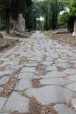 € Рима «через дорогу Appia Antica римскую на окраинах города Стоковое Изображение