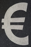 € sign on asphalt Stock Image