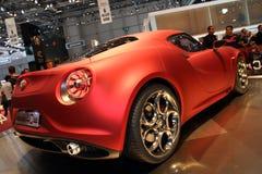 2011 de la demostración de motor de Ginebra Alfa Romeo 4C Imagenes de archivo