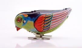 da série do Estanho-Brinquedo que Pecking o pássaro azul Fotografia de Stock Royalty Free