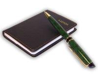 de la pluma y del cuaderno aislado Fotos de archivo
