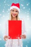 Â-Schönheit mit Sankt-Hut, ein rotes Papier ohne Untertitel halten stockfotos