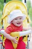 Âge heureux de bébé de 9 mois sur le boguet Images stock