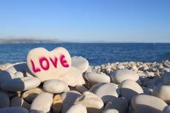 Loveâ écrit sur la plage Photos libres de droits
