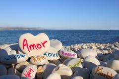 âLoveâ som är skriftlig i olika språk Royaltyfria Bilder