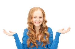 сlueless woman shrugging helpless with her shoulders Royalty Free Stock Photography