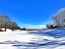 一个空的领域包括雪 免版税图库摄影