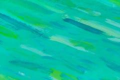 一个绿松石木板的抽象看法有绿色油漆污点的 库存图片