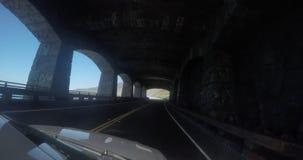 一个路视图通过一个隧道在离太平洋海岸的附近 影视素材