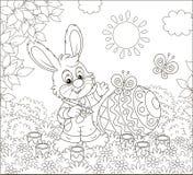 一点上色复活节彩蛋的兔宝宝 免版税库存图片