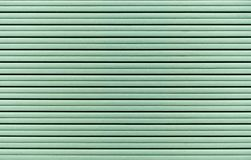 从绿色干式墙板料的背景  修理和建筑的材料 免版税库存图片